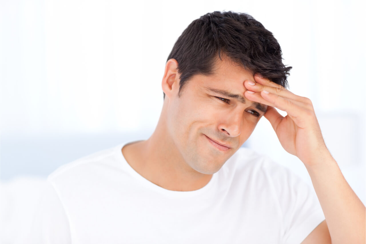 The man suffers from migraine attacks.