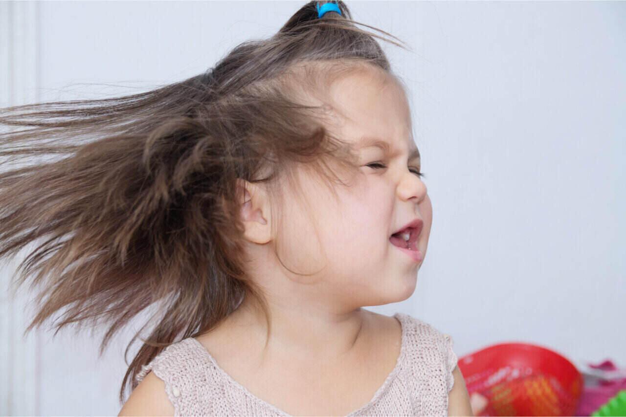 Little kid shaking her cute little head.